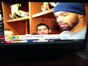 Green Bay Packers linebacker Julius Peppers and I along with other media members following their victory over Atlanta.